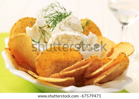 Tortilla chips and curd cheese - stock photo