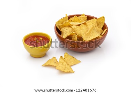 Tortilla chips and sauce - stock photo