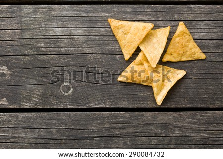 tortilla chips on old wooden table - stock photo