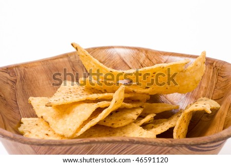 Tortilla Chips or nachos in wooden bowl isolated against white background.