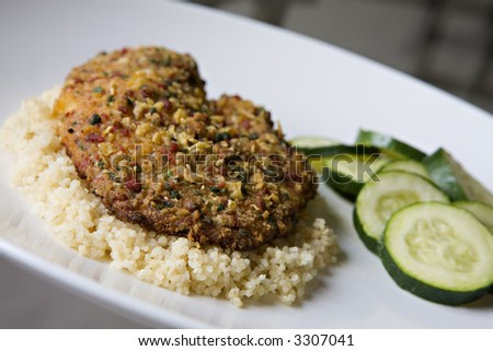 Tortilla-Crusted Tilapia over Whole Wheat Couscous with a side of Steamed Zucchini - stock photo