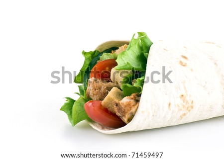 Tortilla filled with lettuce chicken tomatoes and cucumber - stock photo