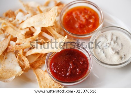 Tortilla nachos chips with three super bowl dips