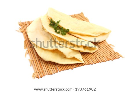 Tortilla Wrap Bread on a bamboo mat Isolated on a white background - stock photo