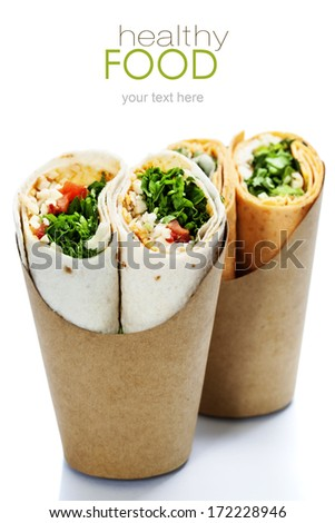 tortilla wraps with chicken and fresh vegetables isolated on white (with easy removable sample text) - stock photo