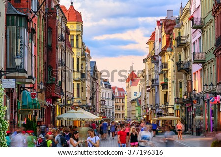 Torun, Poland - July 06: Crowded pedestrian street on a summer evening in the old town of Torun (Thorn), Poland on July 06, 2015
