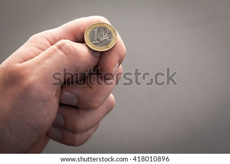 Tossing Euro coin, heads or tails you decide - stock photo