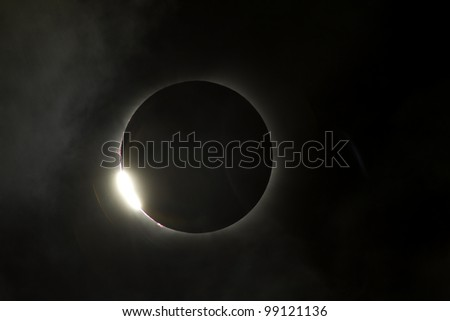 Total eclipse comes to the end with a burst of light - stock photo