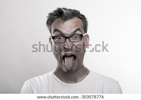 totally disgusted man pokes out his tongue