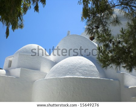 Totally white church located in the village of Chora near the port of Los. - stock photo