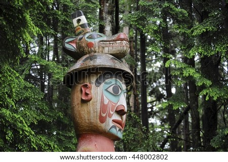 Totem poles are a traditional way of telling the stories of Aboriginal families and clans - stock photo