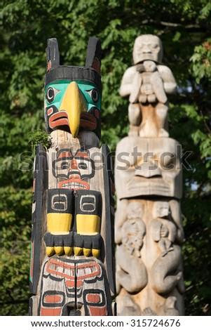 Totem Poles at Brockton Point, Stanley Park - stock photo