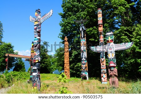 Totems in Stanley Park, Vancouver Canada - stock photo