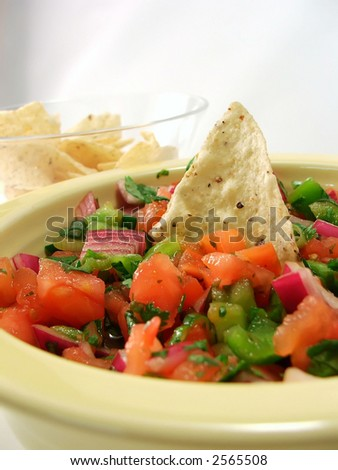 totilla chip in a big bowl of salsa
