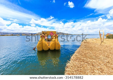 Totora boat on the Titicaca lake near Puno, Peru - stock photo
