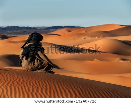 Touareg looks in the desert - stock photo
