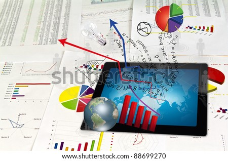 Touch pad and financial Graphs - stock photo