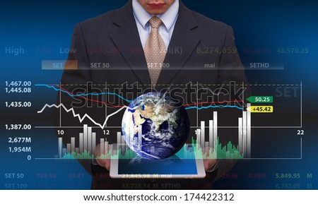 Touch pad and graph report : Elements of this image furnished by NASA - stock photo