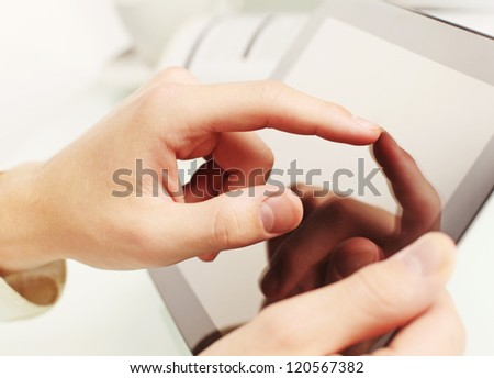 touch pad in hand  on white background - stock photo