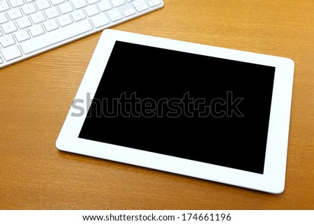 Touch pad on table - stock photo