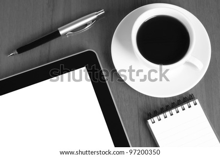Touch screen device, notepad, pen and cup of coffee on wooden background - stock photo