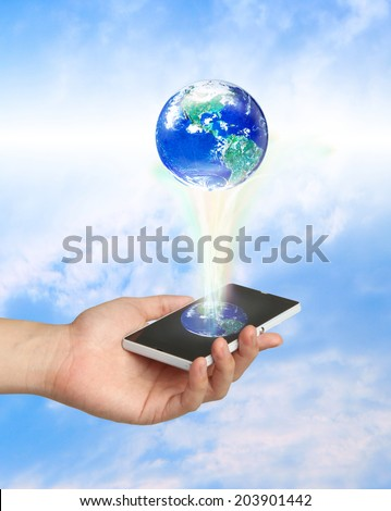 Touch screen mobile phone and a glowing earth globe, Elements of this image furnished by NASA - stock photo