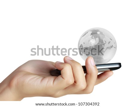 Touch screen mobile phone, in hand and globes - stock photo