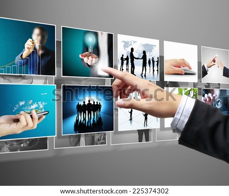 Touch screen, reaching images streaming  - stock photo