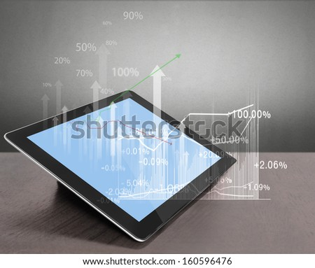 touch screen tablet with the graph  - stock photo