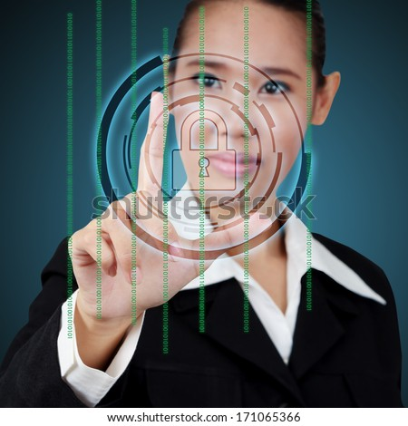 Touching a security key on virtual screen. Concept of business security. - stock photo