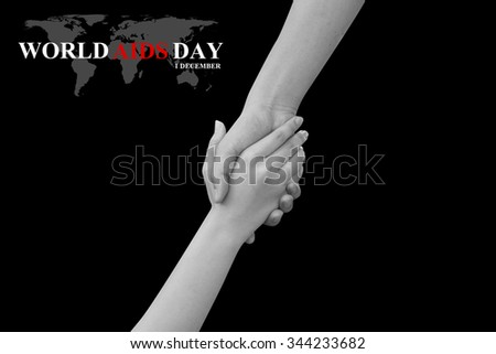 touching and reaching hands concept over black background:symbolic of helping,healing :World Aids Day 1 December concept:Human immunodeficiency virus infection:acquired immune deficiency syndrome - stock photo