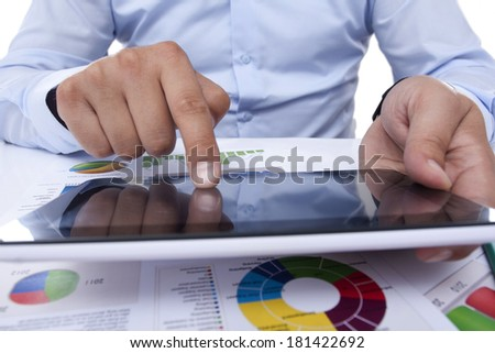 touching the digital tablet  in the office - stock photo