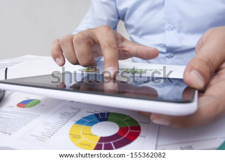 touching the tablet in the office - stock photo