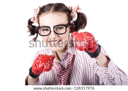 Tough And Ambitious Business Woman Punching On In A Pair Of Boxing Gloves In A Depiction Of Hard Hitting Business Tactics