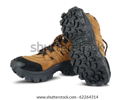 Tough hiking shoes in the white background - stock photo