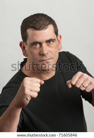 Tough man ready to fight fists up - stock photo