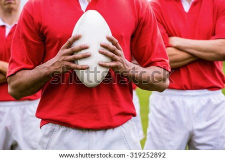 Tough rugby players ready to play at the park - stock photo