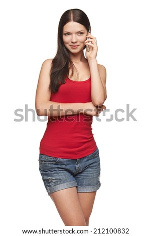 Toughtful casual woman talking at cell phone, looking away, isolated over white background - stock photo