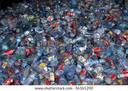 TOULOUSE, FRANCE - CIRCA 2009: Clear plastic bottles lie in a heap at an undisclosed recycling facility circa 2009 in Toulouse. The plastic is gathered by color and type to be recycled. - stock photo