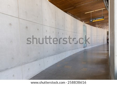 TOULOUSE, FRANCE - JULY 27, 2014: Corridor to the gate at Toulouse-Blagnac airport in Toulouse, France. In 2012, the Toulouse airport served 7,559,350 passengers. - stock photo