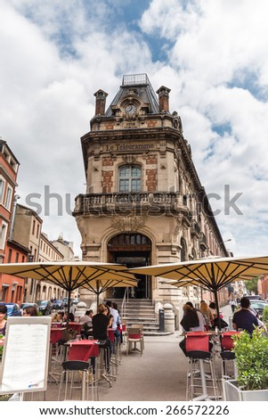 TOULOUSE, FRANCE - JULY 22, 2014: Le Telegramme is a mythical building in Toulouse, built in 1912. It houses a restaurant re-opened in October 2012 after a two year refurbishment. - stock photo