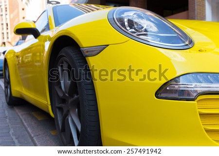 TOULOUSE, FRANCE - JULY 22, 2014: Parked bright yellow Porsche 911 with characteristic oval shaped headlights. - stock photo