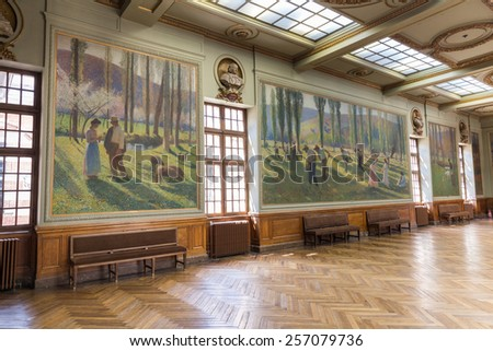TOULOUSE, FRANCE - JULY 21, 2014: Salle Henri Martin in the Capitole de Toulose is decorated with ten giant canvases by Henri Martin. Henri-Jean Guillaume Martin was a renowned French impressionist painter.