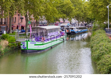 TOULOUSE, FRANCE - JULY 21, 2014: The Canal du Midi is a 241 km long canal in Southern France. The canal has been used to transport passengers and goods but is now used primarily for recreation.  - stock photo