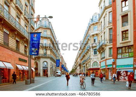 Toulouse, France - November 02 2015: unidentified people walk along the streets of Toulouse, in the historic center
