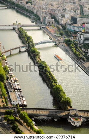 tour boat navigating the Seine river - stock photo