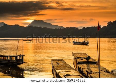 Tour boats in Mekong river, Luang Prabang, Laos - stock photo