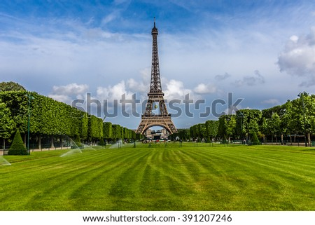 Tour Eiffel (Eiffel Tower) located on Champ de Mars in Paris, named after engineer Gustave Eiffel. Eiffel Tower is tallest structure in Paris and most visited monument in the world. France.  - stock photo