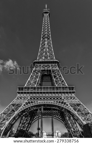 Tour Eiffel (Eiffel Tower) located on Champ de Mars, named after engineer Gustave Eiffel. Eiffel Tower is tallest structure in Paris and most visited monument in world. France. Black and white. - stock photo