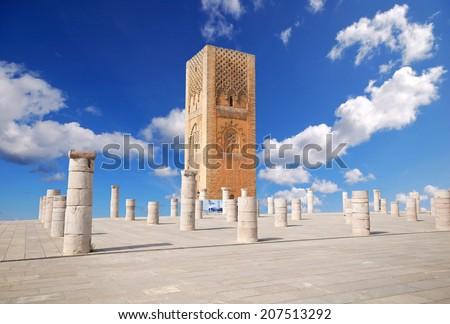 Tour Hassan tower in the square with stone columns. Made of red sandstone, important historical and tourist complex in Rabat, Morocco. Instead of stairs, the tower is ascended by ramps